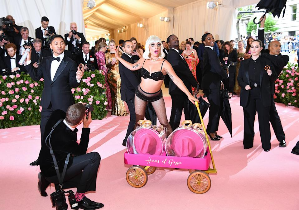 Lady Gaga's final look was a glitzy lingerie set complete with fishnet tights [Photo: Getty]