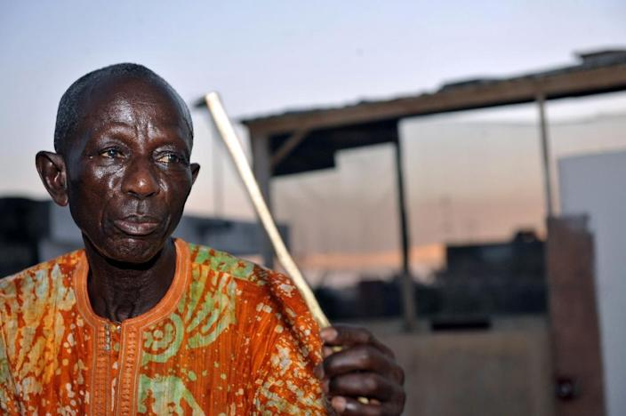 Senegalese drum master Doudou Ndiaye Rose holds a stick as he plays the traditional Sabar drums in Dakar on October 14, 2010 (AFP Photo/Seyllou Diallo)