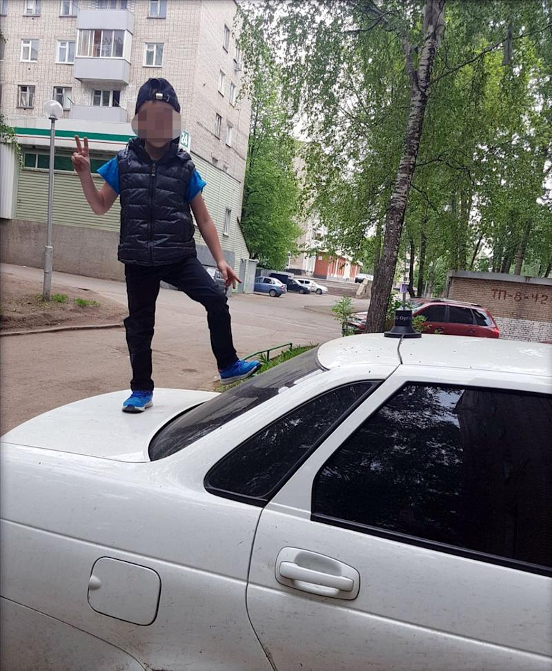 Agina Altynbayeva's son can be seen wearing a blue hat and jacket while posing on the roof of the Hyundai Solaris. Source: AUSTRALSCOPE/EAST2WEST
