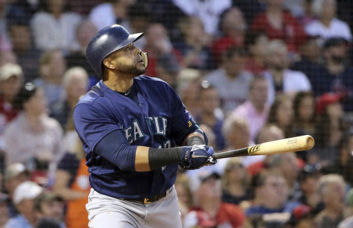 Seattle Mariners' Nelson Cruz watches his three-run home run during the fourth inning of the team's baseball game against the Boston Red Sox at Fenway Park, Friday, June 22, 2018, in Boston. (AP Photo/Elise Amendola)