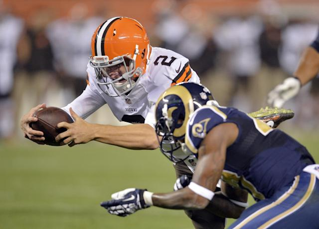 Cleveland Browns quarterback Johnny Manziel (2) dives into the end zone for a touchdown against the St. Louis Rams in the third quarter of a preseason NFL football game Saturday, Aug. 23, 2014, in Cleveland. (AP Photo/David Richard)