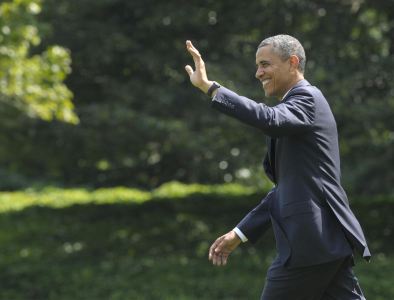President Barack Obama waves as he walks to Marine One on the South Lawn of the White House in Washington, Monday, July 30, 2012. Obama is heading to New York City for fundraising events. (AP Photo/Susan Walsh)