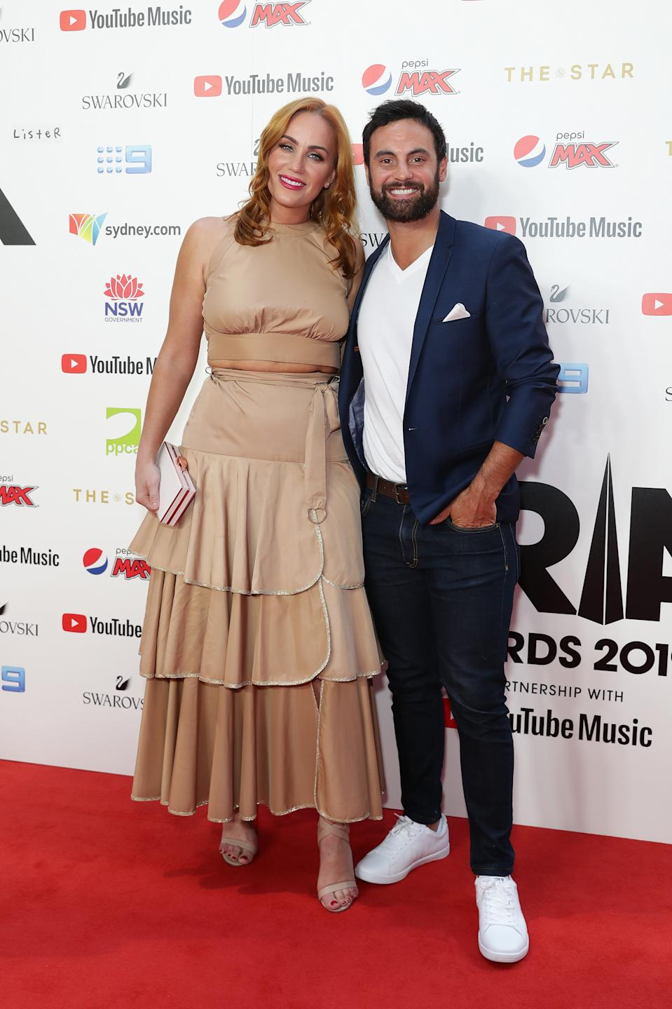 Jules Robinson and Cameron Merchant arrive for the 33rd Annual ARIA Awards 2019. Photo: Getty Images
