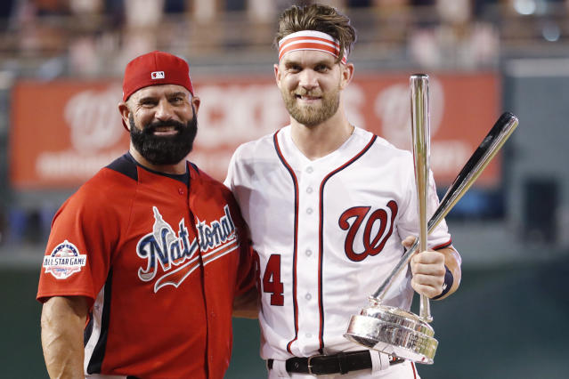Ron Haper rapid-fired pitches to his son, Bryce, in his Home Run Derby win, and people are livid. (AP Photo)