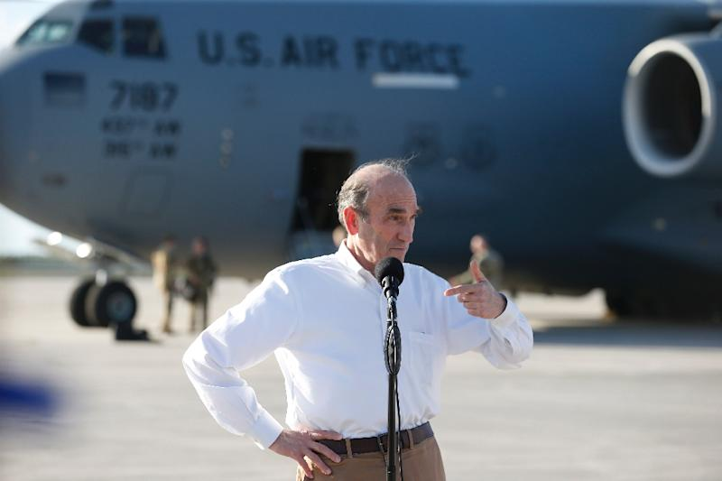 US Special Representative Elliott Abrams speaks with the media before the departure of a C-17 cargo plane loaded with food, water and medicine for a humanitarian mission to Venezuela, at Homestead Air Force Base in Florida, on February 22, 2019 (AFP Photo/RHONA WISE)