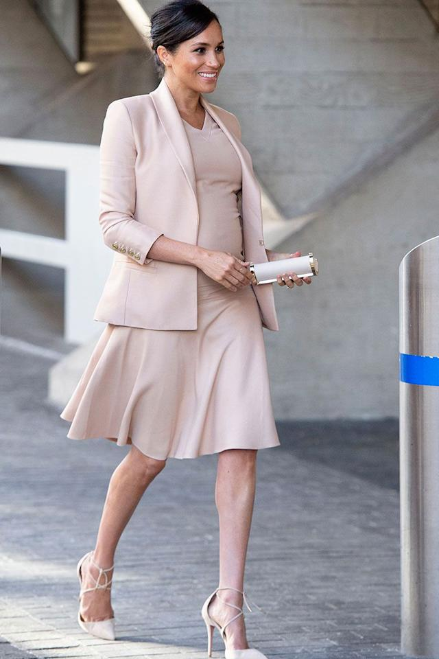 <p>For her first visit as patron of the National Theatre, Meghan wore a £1,728 Brandon Maxwell mini dress with a matching £2,004 blazer, £440 Aquazzura pumps and a Carolina Herrera clutch. She added a sleek updo to finish the look. </p>