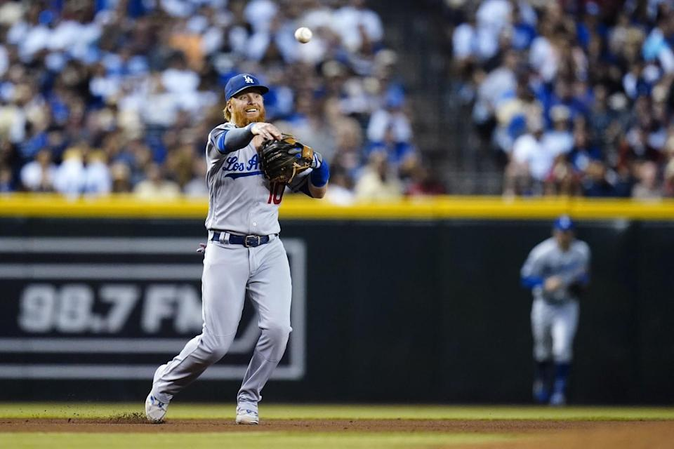 Dodgers third baseman Justin Turner makes a throwing error during the fourth inning Sept. 25, 2021.