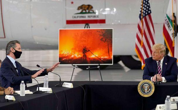 PHOTO: President Donald Trump listens as California Gov. Gavin Newsom, left, speaks about the western wildfires during a briefing at Sacramento McClellan Airport, in McClellan Park, Calif., Sept. 14, 2020. (Andrew Harnik/AP)