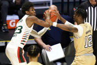Georgia Tech forward Khalid Moore (12) defends against Miami guard Kameron McGusty (23) during the first half of an NCAA college basketball game, Saturday, Feb. 20, 2021, in Coral Gables, Fla. (AP Photo/Lynne Sladky)