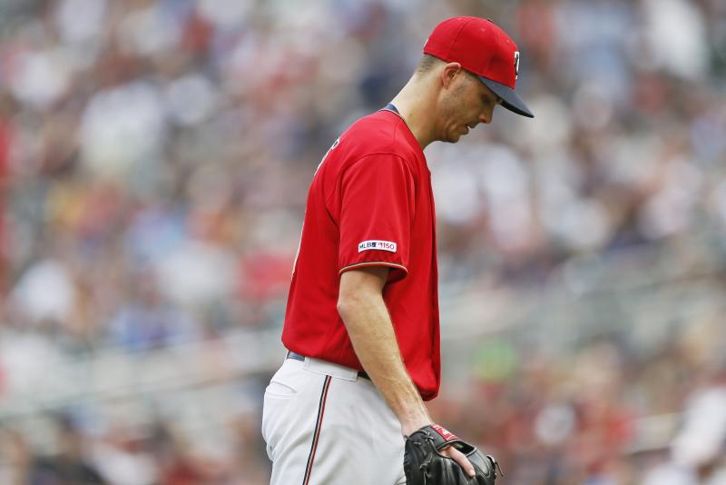 Minnesota Twins pitcher Taylor Rogers heads to the dugout after he was pulled in the 10th inning of a baseball game shortly after giving up a grand slam to Cleveland Indians' Carlos Santana, Sunday, Aug. 11, 2019, in Minneapolis. (AP Photo/Jim Mone)