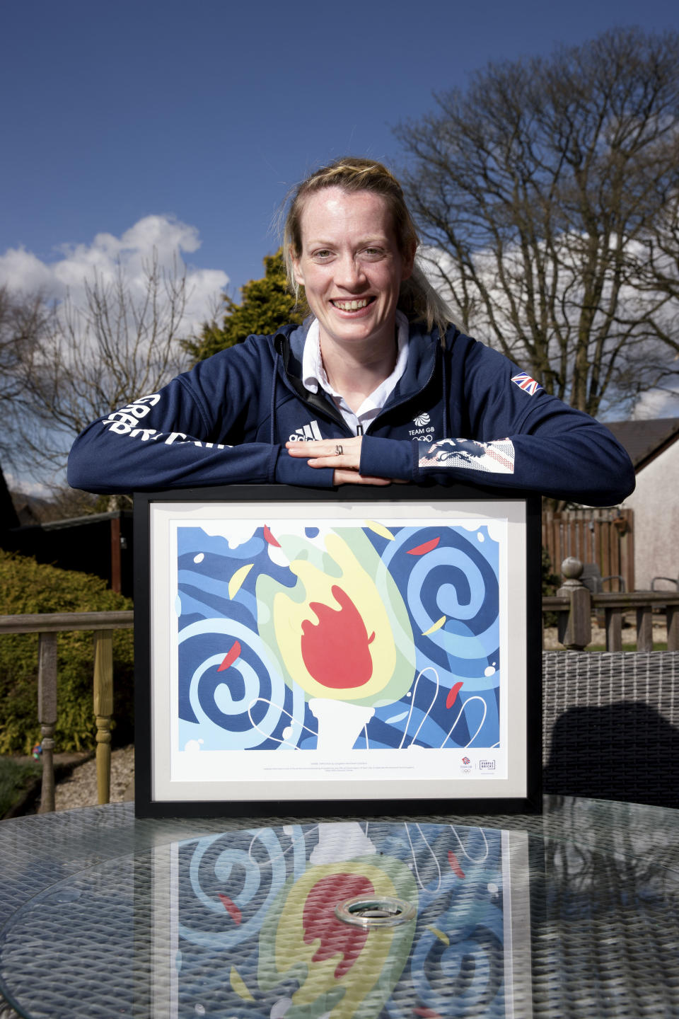 Delighted Doyle was presented with a specially commissioned piece of artwork designed to rally support for Team GB athletes