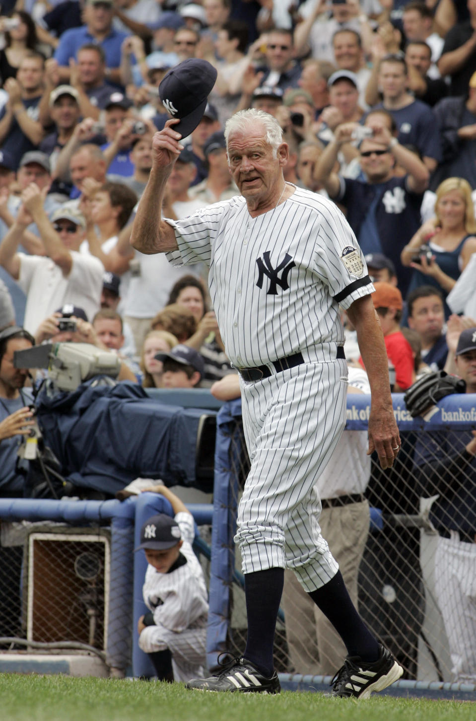 FILE - In this Aug. 2, 2008, file photo, Former New York Yankees picher Don Larsen tips his hat to fans during introduction ceremonies before an old-timers baseball game at Yankee Stadium in New York. Larsen, the journeyman pitcher who reached the heights of baseball glory in 1956 for the Yankees when he threw a perfect game and the only no-hitter in World Series history, died Wednesday night, Jan. 1, 2020. He was 90. (AP Photo/Ed Betz, File)