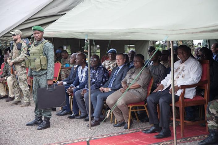 """<div class=""""inline-image__caption""""><p>President Touadera, CAR's Defense Minister Marie-Noelle Koyara and the First Secretary of the Russian Embassy, Victor Tokmakov, attend the training of the Central African Armed Forces in Berengo on August 4, 2018. Russian military consultants set up training for the Central African Armed Forces and the Internal Security Forces after delivering weapons to the country.</p></div> <div class=""""inline-image__credit"""">FLORENT VERGNES/AFP via Getty Images</div>"""