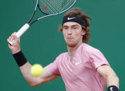 Andrey Rublev of Russia returns the ball to Stefanos Tsitsipas of Greece during the Monte Carlo Tennis Masters tournament finals in Monaco, Sunday, April 18, 2021. (AP Photo/Jean-Francois Badias)