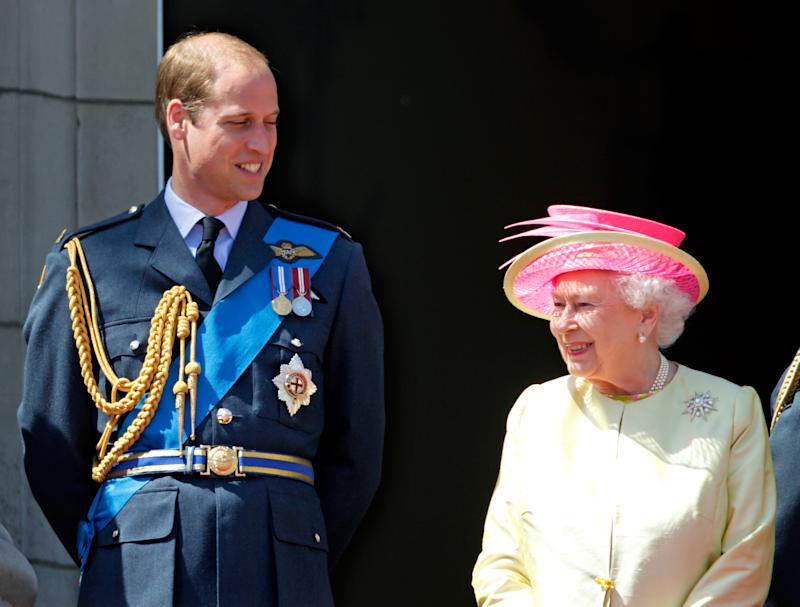 Prince William, Duke of Cambridge and Queen Elizabeth II watch a flypast of Spitfire & Hurricane aircraft from the balcony of Buckingham Palace to commemorate the 75th Anniversary of The Battle of Britain on July 10, 2015 in London, England.