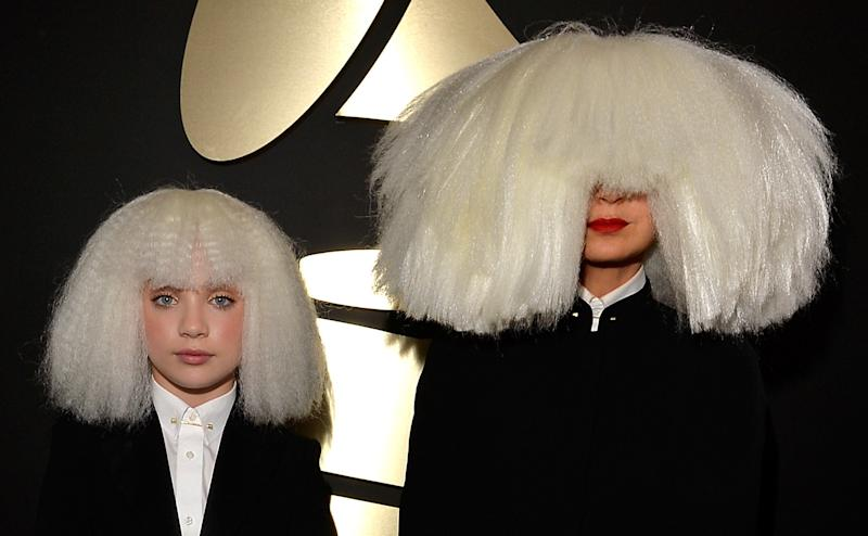 Dancer Maddie Ziegler (L) and singer/songwriter Sia attend The 57th Annual GRAMMY Awards in 2015.