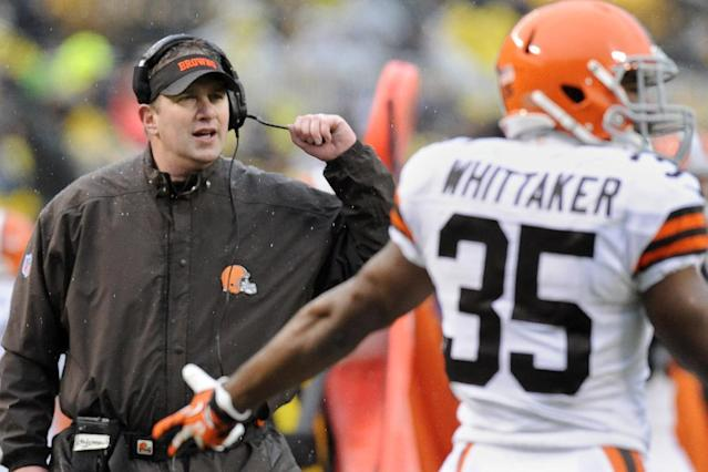 Cleveland Browns head coach Rob Chudzinski, left, looks to an official along with running back Fozzy Whittaker (35) in the second quarter of an NFL football game against the Pittsburgh Steelers, Sunday, Dec. 29, 2013, in Pittsburgh. The Steelers won 20-7. (AP Photo/Don Wright)