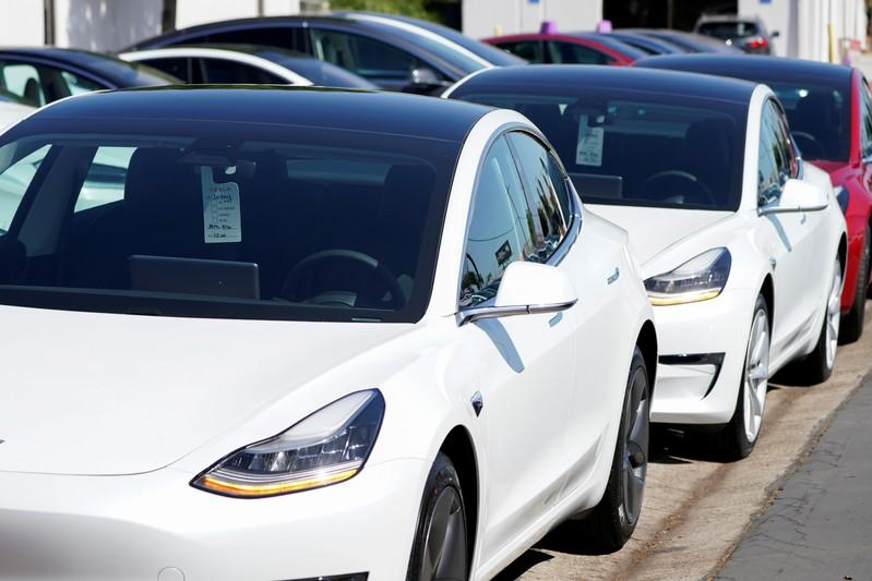 FILE PHOTO: FILE PHOTO: A new Tesla Model 3 is shown at a delivery center on the last day of the company's third quarter, in San Diego