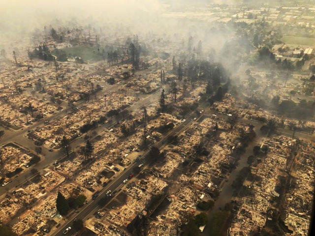 <p>This aerial photo provided by the California Highway Patrol Golden Gate Division shows some of hundreds of homes destroyed by a wind-driven wildfire that swept through Santa Rosa, Calif., early Monday, Oct. 9, 2017. (Photo: California Highway Patrol Golden Gate Division via AP) </p>
