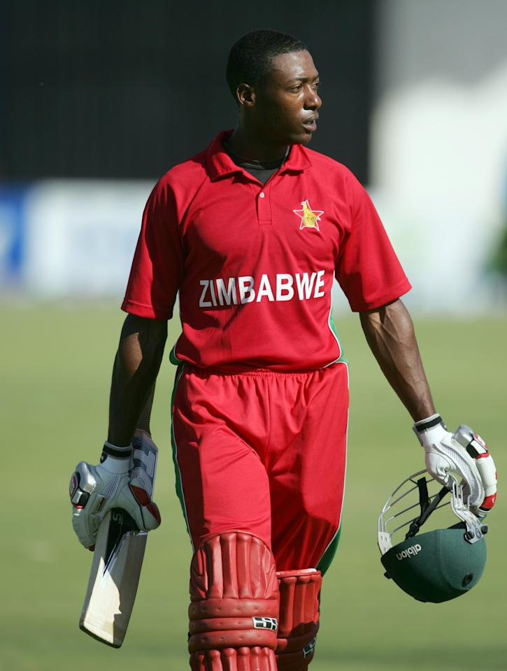 A dejected Vusimuzi Sibanda walks off the pitch after losing his wicket during the first game of the three match ODI cricket series between Pakistan and hosts Zimbabwe at the Harare Sports Club on August 27, 2013.AFP PHOTO / JEKESAI NJIKIZANA        (Photo credit should read JEKESAI NJIKIZANA/AFP/Getty Images)