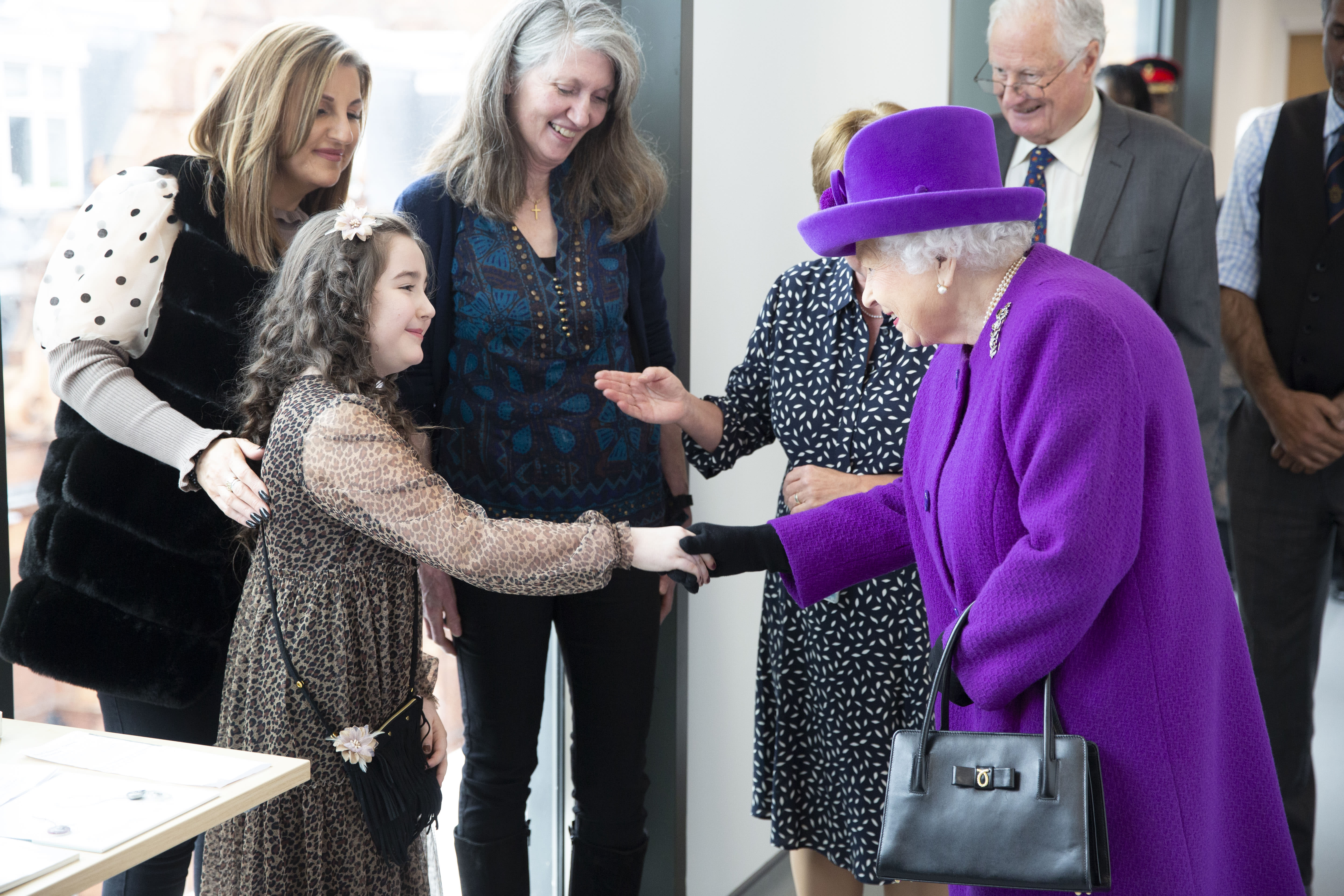 LONDON, ENGLAND - FEBRUARY 19: Queen Elizabeth II meets Lily Conkan, aged 8, who is having braces fitted, as she opens the new premises of the Royal National ENT and Eastman Dental Hospital on February 19, 2020 in London, England. (Photo by Heathcliff O'Malley - WPA Pool/Getty Images)