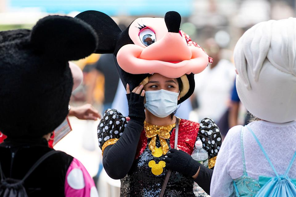 A woman costumed as Minnie Mouse wears a mask to prevent against the spread of coronavirus disease (COVID-19), as the highly transmissible Delta variant has led to a surge in infections, in New York City, U.S., July 30, 2021. REUTERS/Eduardo Munoz     TPX IMAGES OF THE DAY