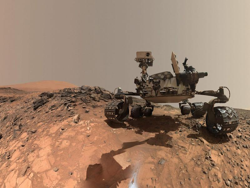 """'Curiosity' at the site from which it reached down to drill into a rock target called """"Buckskin"""" on lower Mount Sharp: AFP"""