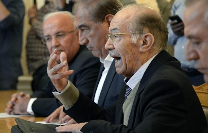 """Hassan Abdel Azim (R) of the Syrian opposition bloc National Coordination Committee for Democratic Change, pictured August 31, 2015, said November 15 that Vienna talks had set out a """"practical plan"""" for a political solution to his country's crisis (AFP Photo/Alexander Nemenov)"""