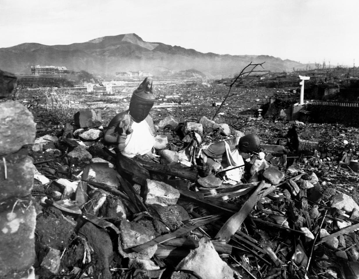 <p>Battered religious figures rest among the rubble of Nagasaki after the atomic bombing of the city by American armed forces on Aug. 9, 1945. (Photo: Corbis via Getty Images) </p>