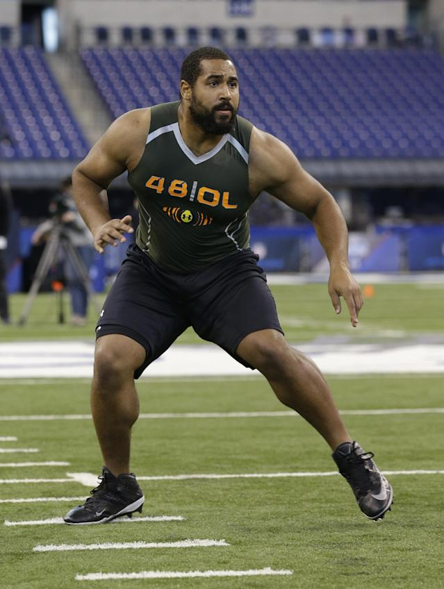 FILE - In this Feb. 22, 2014 file photo, Penn State offensive lineman John Urschel runs a drill at the NFL football scouting combine in Indianapolis. The most exciting thing about finishing the combine is that I am no longer training like a track athlete. I am once again a football player, and now am focused on doing all I can to ensure that I am prepared for my pro day.(AP Photo/Michael Conroy, File)