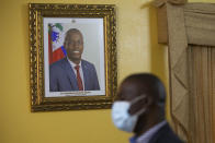 A picture of late Haitian President Jovenel Moise hangs on the wall of Haiti's Prime Minister Ariel Henry´s residence, in Port-au-Prince, Tuesday, Sept. 28, 2021. (AP Photo/Joseph Odelyn)