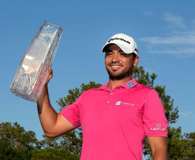 Jason Day celebrates with the trophy during the final round of The Players Championship. (PGA TOUR)