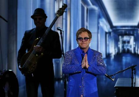 """Musician Elton John reacts after performing """"Home Again"""" in a musical tribute to Liberace at the 65th Primetime Emmy Awards in Los Angeles"""