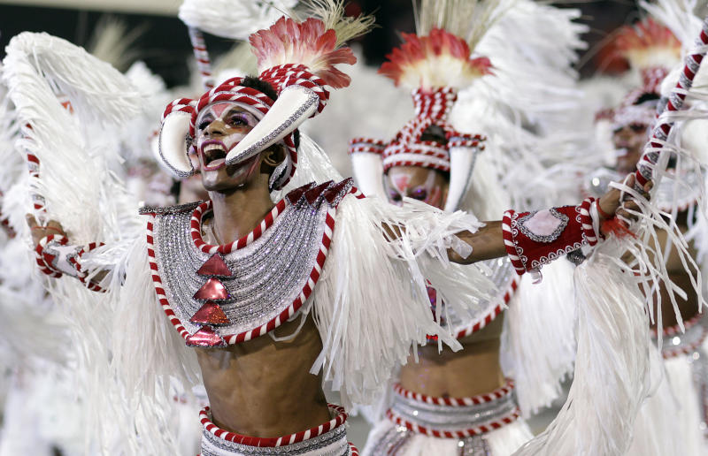Carnival dancers perform during a parade by the Mocidade Alegre samba school in Sao Paulo, Brazil, early Sunday Feb. 19, 2012. Carnival runs Feb. 17-21. (AP Photo/Andre Penner)