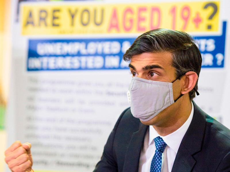 Rishi Sunak talks with staff as he visits a Jobcentre Plus in Barking, east London (POOL/AFP/Getty)