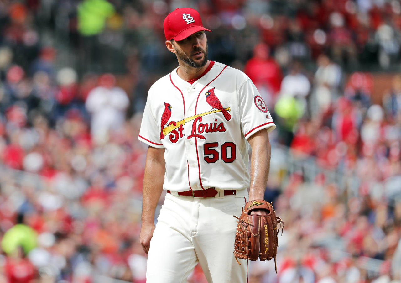 FILE - In this Sept. 22, 2018, file photo, St. Louis Cardinals starting pitcher Adam Wainwright walks off the field after being removed in the seventh inning of a baseball game against the San Francisco Giants in St. Louis. Wainwright's contract with the Cardinals has been put on hold because it violates the maximum-cut rule, and the pitcher will have to become a free agent before the agreement can be finalized, people familiar with the deal told The Associated Press, Thursday, Oct. 18, 2018. St. Louis announced the agreement with the 37-year-old right-hander on Oct. 11. He was earning $19.5 million annually, and the new deal guarantees less than $15.6 million. (AP Photo/Jeff Roberson, FIle)