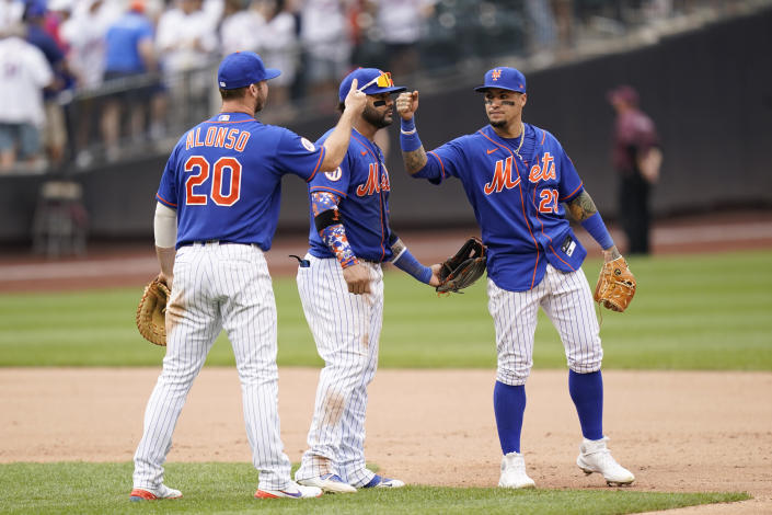 New York Mets first baseman Pete Alonso (20), left, third baseman Jonathan Villar, center, and shortstop Javier Baez (23) celebrate their win after a baseball game against the Washington Nationals, Sunday, Aug. 29, 2021, in New York. (AP Photo/Corey Sipkin)