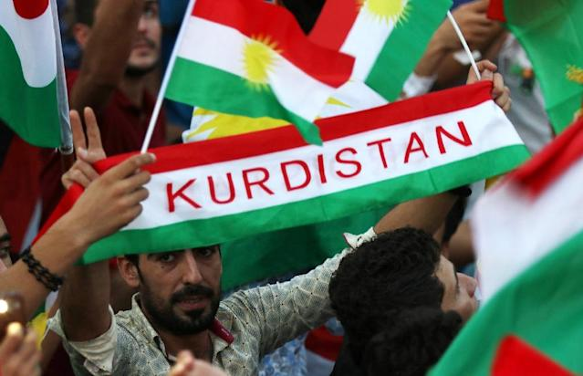 <p>Iraqi Kurds fly Kurdish flags during an event on Sept. 16, 2017, to urge people to vote in the upcoming independence referendum in Arbil, the capital of the autonomous Kurdish region of northern Iraq. (Photo: Safin Hamed/AFP/Getty Images) </p>