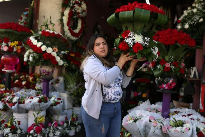 A woman sells flowers in the flower district ahead of Valentine's Day in Los Angeles