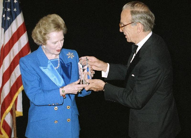 FILE - In this Nov. 14, 1991, file photo, Margaret Thatcher accepts the United Cerebral Palsy of New York's 37th Annual Humanitarian Award in New York from Rupert Murdoch. Prime Ministers come and go, but News Corp. chief Rupert Murdoch stays and stays and stays. Murdoch has played a key role in shaping political British political coverage for the last four decades, and testimony at the Leveson inquiry into media ethics has highlighted how prime ministers have both courted and feared the 81-year-old media mogul. (AP Photo/Mike Albans, File)