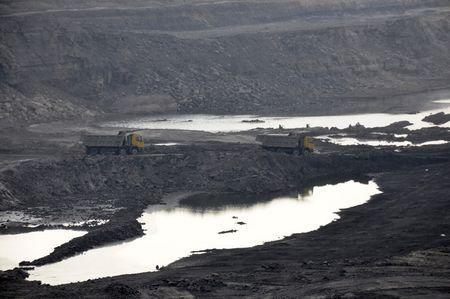 Trucks carrying coal move at Magadh coal mine in Chatra district in the eastern state of Jharkhand, India, September 30, 2015.REUTERS/Stringer