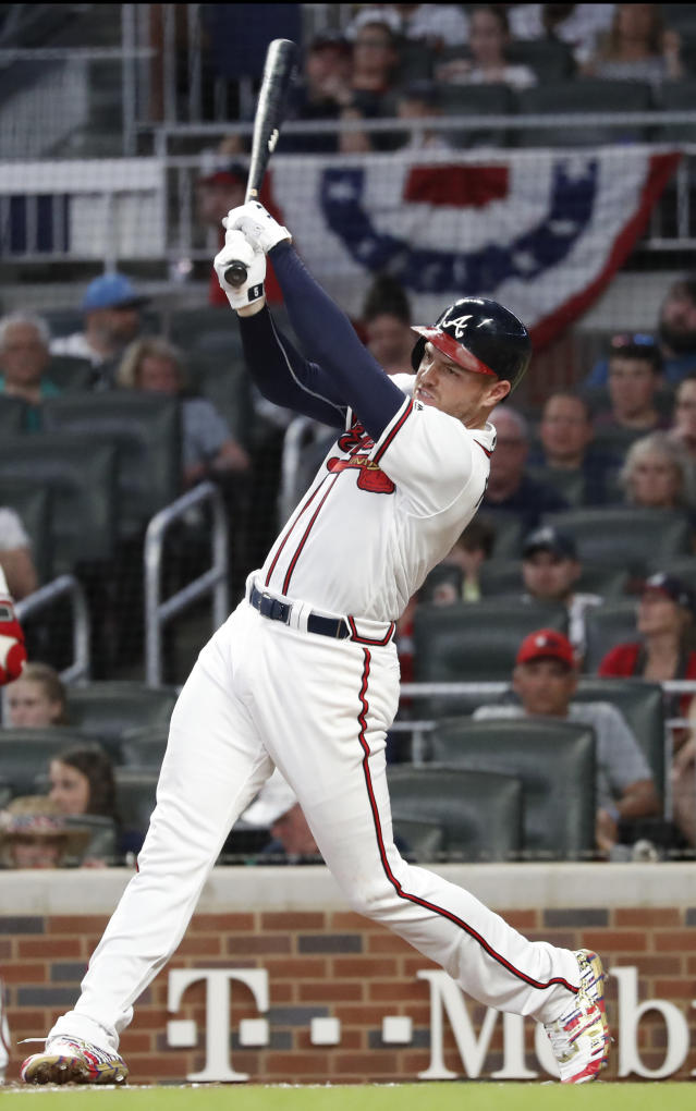 Atlanta Braves first baseman Freddie Freeman follows through on a home run during the fourth inning of the team's baseball game against the Philadelphia Phillies on Thursday, July 4, 2019, in Atlanta. (AP Photo/John Bazemore)