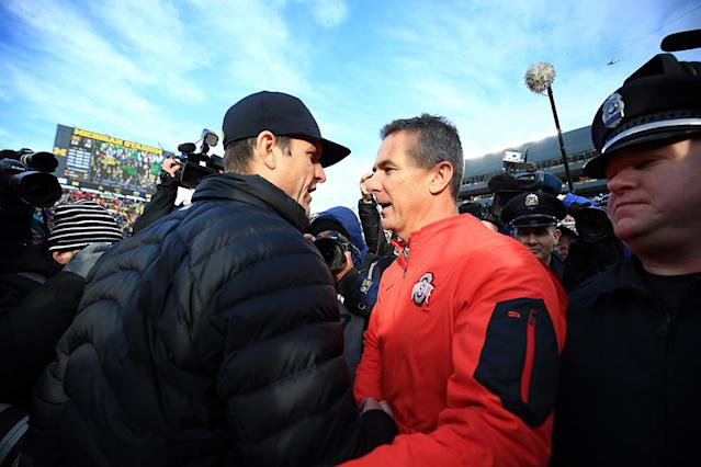 Jim Harbaugh's first meeting against Urban Meyer was an Ohio State rout last year. (Getty Images)