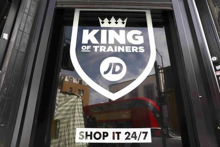 A sign for a JD Sports store is displayed in a window in London, Britain April 11, 2017. Shares in Britain's JD Sports Fashion Plc climbed to a record high after strong demand for leisure clothing helped to drive a 55 percent rise in headline annual pretax profit, its biggest increase in eight years REUTERS/Neil Hall