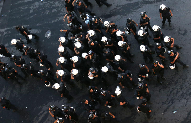 Riot policemen prepare during clashes with protesters at Taksim Square in Istanbul, Turkey, Saturday, June 22, 2013. (AP Photo/Petr David Josek)