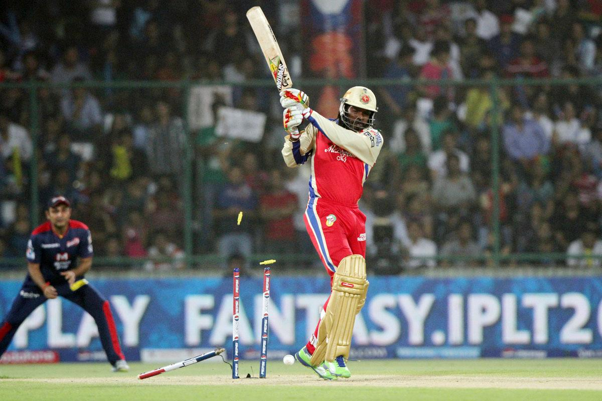 Royal Challengers Bangalore player Chris Gayle bowled by Delhi Daredevils player Irfan Pathan during match 57 of of the Pepsi Indian Premier League between Delhi Daredevils and the Royal Challengers Bangalore held at the Feroz Shah Kotla Stadium, Delhi on the 10th May 2013. (BCCI)
