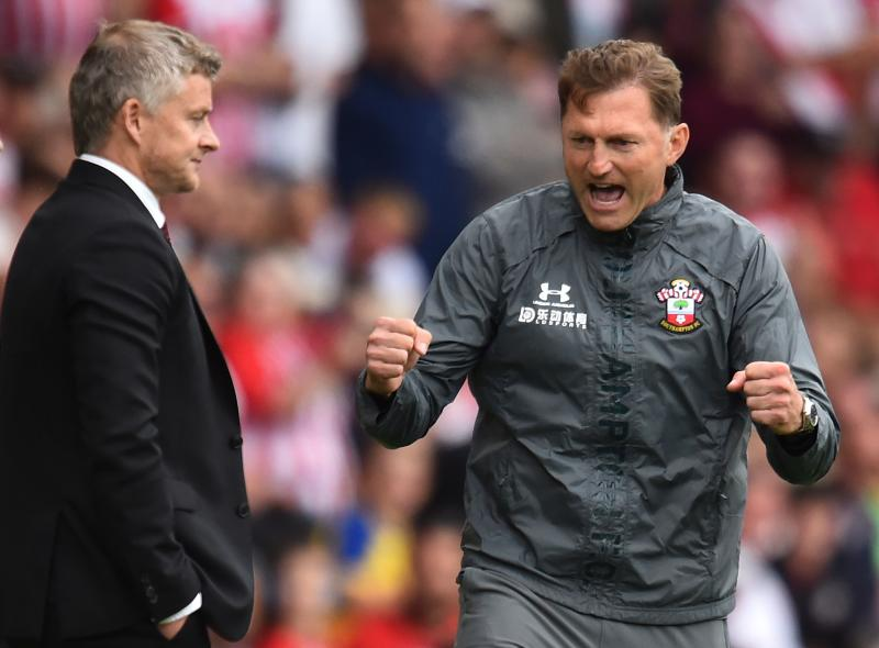 Southampton's Austrian manager Ralph Hasenhuttl (R) celebrates at the final whistle next to Manchester United's Norwegian manager Ole Gunnar Solskjaer (L) during the English Premier League football match between Southampton and Manchester United at St Mary's Stadium in Southampton, southern England on August 31, 2019. (Photo by Glyn KIRK / AFP) / RESTRICTED TO EDITORIAL USE. No use with unauthorized audio, video, data, fixture lists, club/league logos or 'live' services. Online in-match use limited to 120 images. An additional 40 images may be used in extra time. No video emulation. Social media in-match use limited to 120 images. An additional 40 images may be used in extra time. No use in betting publications, games or single club/league/player publications. / (Photo credit should read GLYN KIRK/AFP/Getty Images)