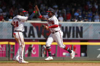 Atlanta Braves center fielder Ronald Acuna Jr., right, and second baseman Adeiny Hechavarria (24) celebrate after defeating Philadelphia Phillies. 5-4 in a baseball game Thursday, Sept. 19, 2019, in Atlanta. (AP Photo/John Bazemore)