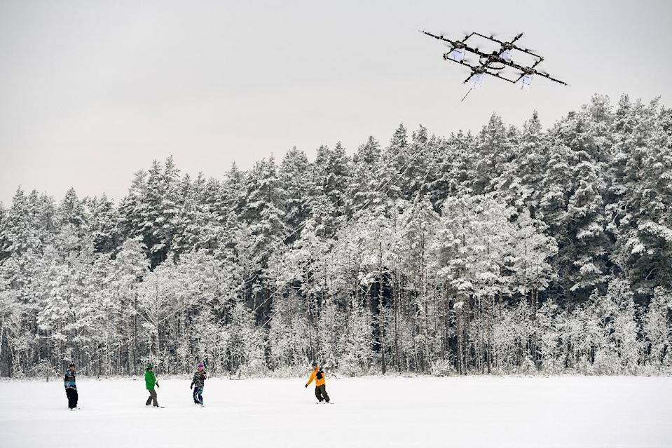 Droneboarders stand on snowboards and grip tow ropes, like those used in water-skiing, and are pulled along by a drone at speeds of up to 60 kph (AFP Photo/Ilmars ZNOTINS)