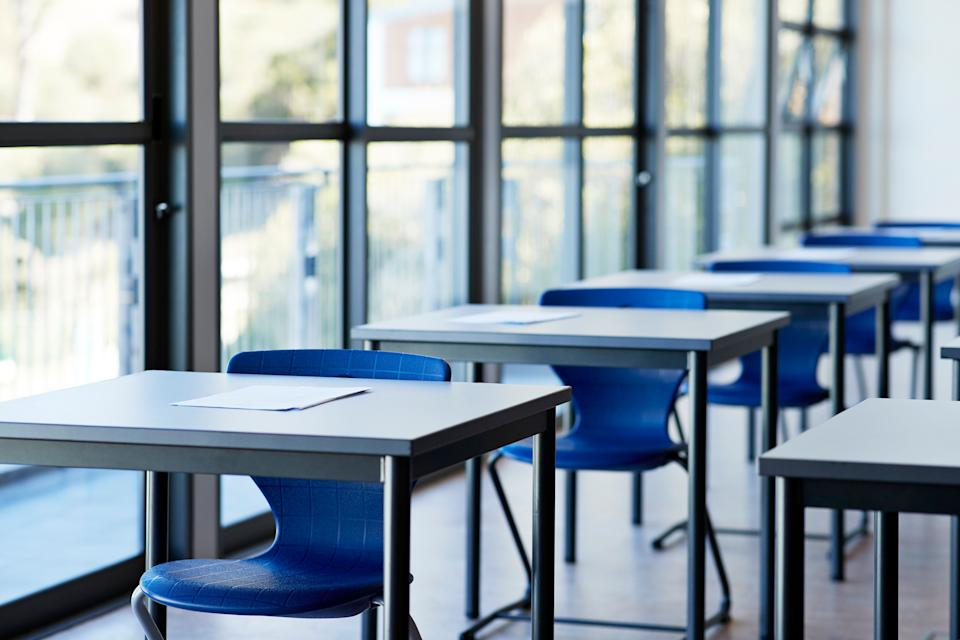 Papers on desks by window in classroom at university (Photo: Klaus Vedfelt via Getty Images)